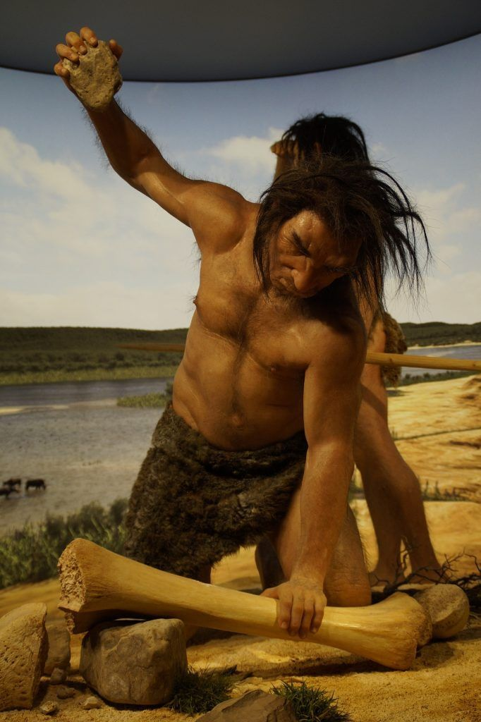 A prehistoric man who acts with a simple stone to modify a big bone: with little human being can accomplish a lot.